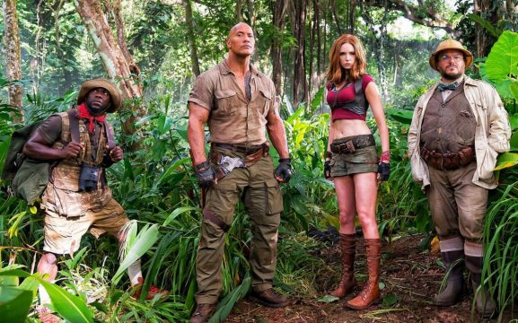 "Jumanji Star Karen Gillan Assures Fans There's A Reason Behind Her ""Child-Sized Clothes"""