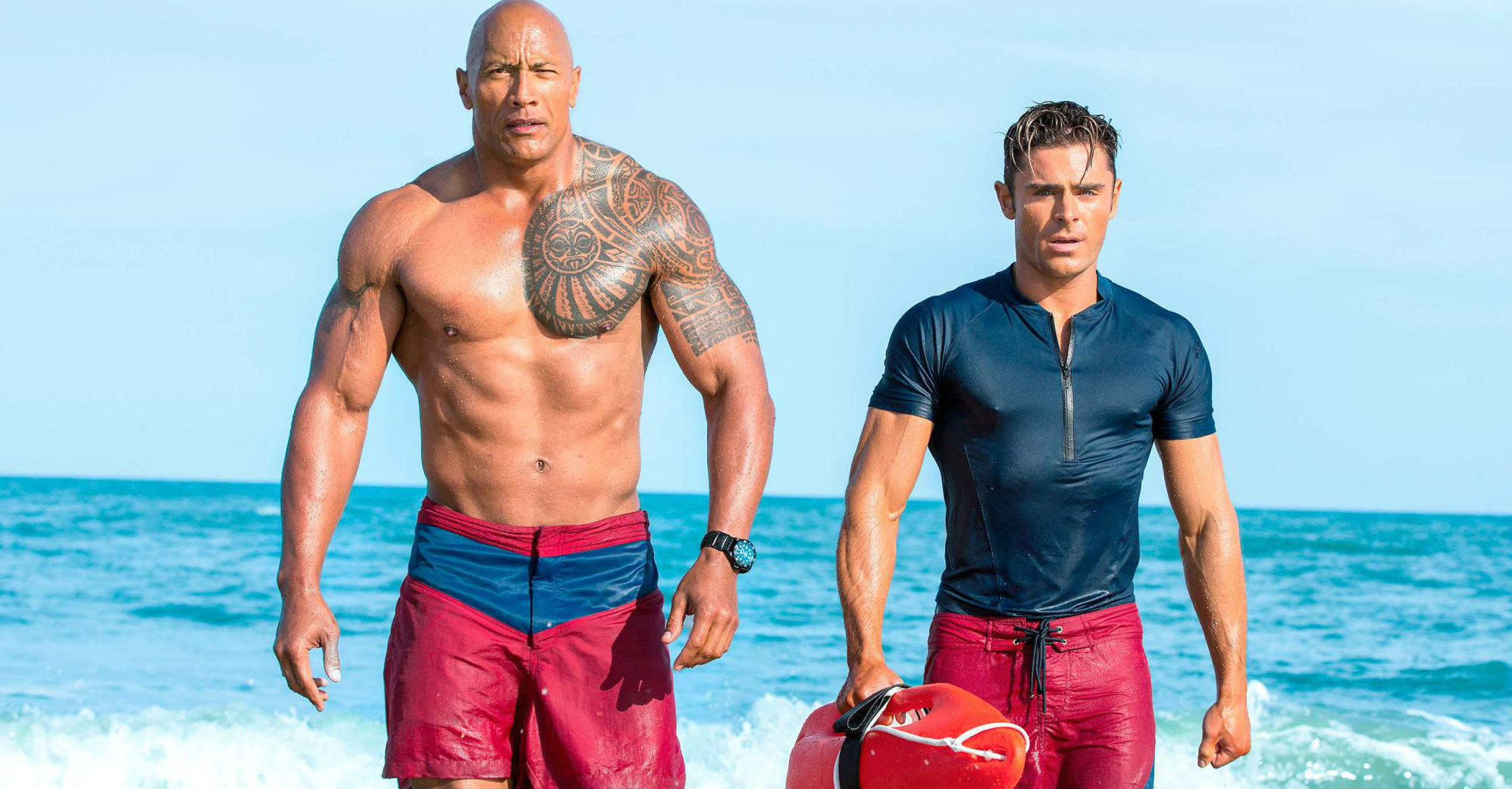 Dwayne Johnson And Zac Efron Strut Their Stuff In New Baywatch Image