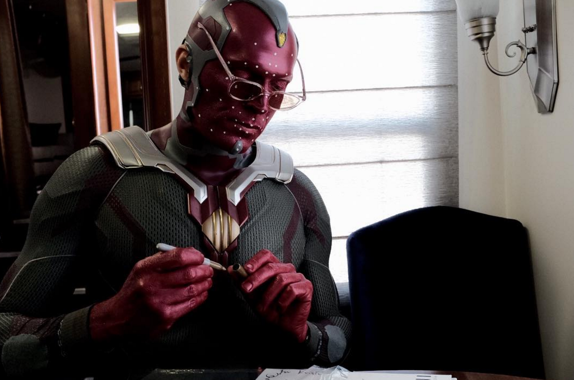 Candid BTS Pic From Avengers 4 Finds Vision Doing Some Paperwork