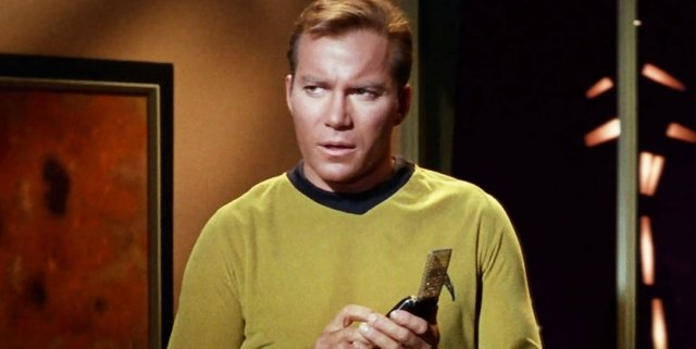 Captain-Kirk-Using-a-Communicator-in-Star-Trek
