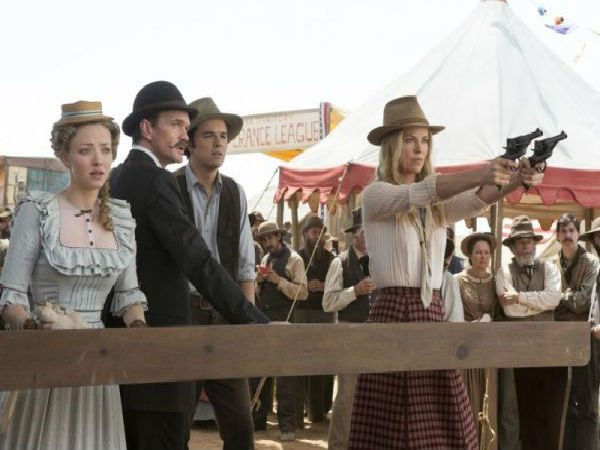 Charlize Theron Wields Two Revolvers In New Photo From A Million Ways To Die In The West