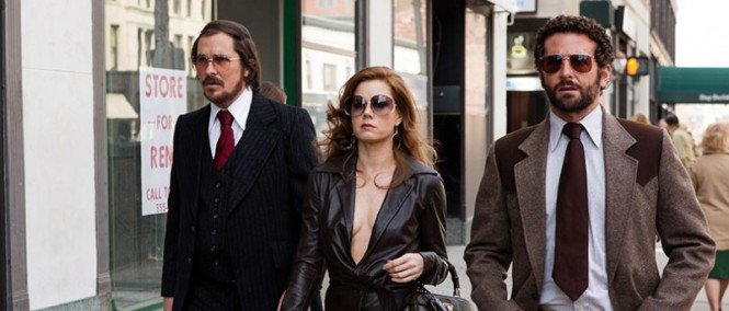 Christian Bale, Amy Adams and Bradley Cooper in American Hustle