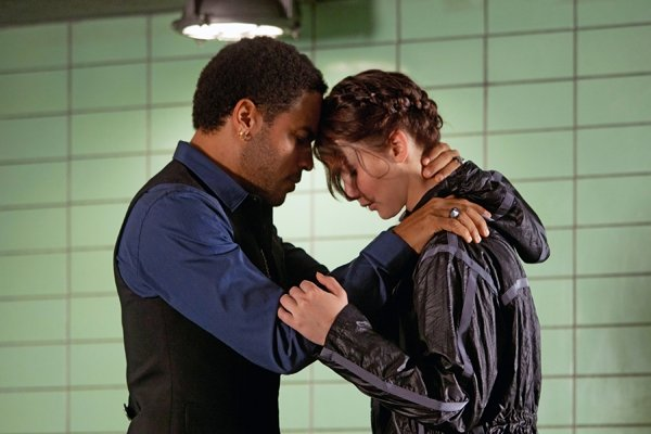 Cinna Comforts Katniss In New Photo From The Hunger Games