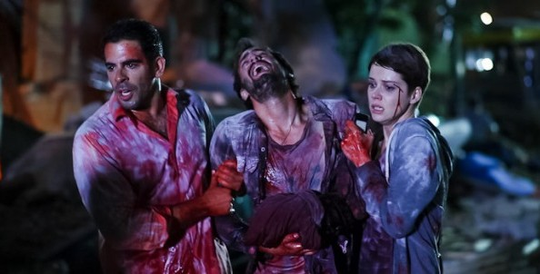 Eli-Roth-and-Andrea-Osvárt-in-Aftershock-2013-Movie-Image-600x302-594x302