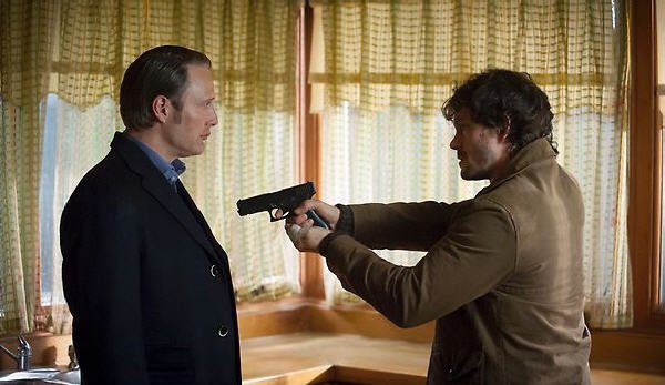 Hannibal with a gun pointed at him
