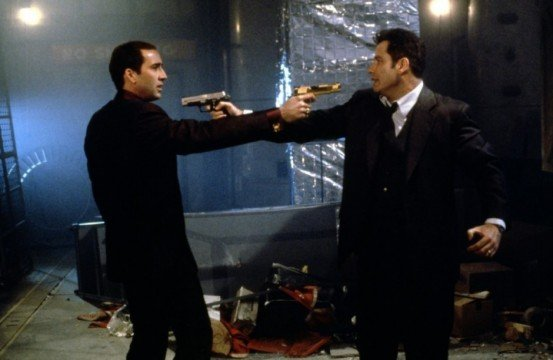 Nicolas Cage and John Travolta in Face Off 1997 Movie Image e1348239946514 553x360 We Got This Covereds Top 100 Action Movies