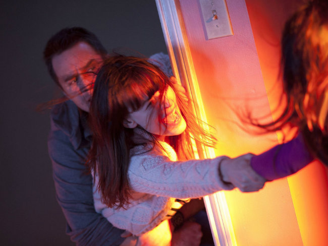 Sam Rockwell and Rosemarie Dewitt in Poltergeist