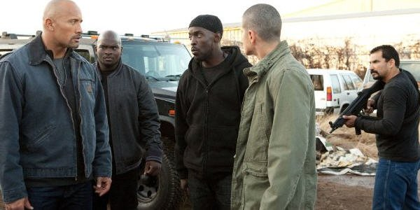 Dwayne Johnson and Michael Kenneth Williams in Snitch