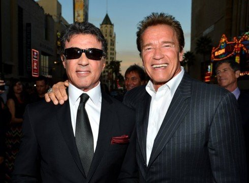 Sylvester Stallone and Arnold Schwarzenegger at the Los Angeles premiere 490x360 Arnold Schwarzenegger vs. Sylvester Stallone: 5 Of Their Best Movies