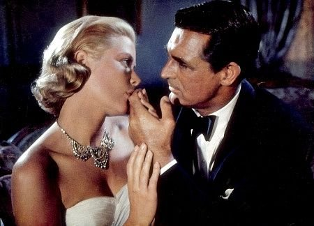 To catch a thief Kelly kissing Grants fingers 9 Movies That Celebrate The Art Of The Heist In All Its Forms