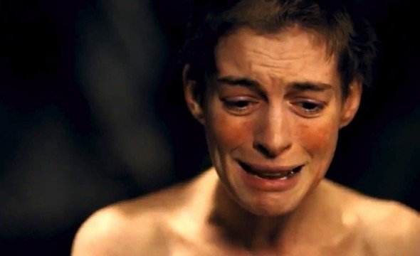 anne hathaway short hair crying in les miserables 2012 590x360 Truly Miserable: 5 Of The Most Tearjerking Scenes From Les Miserables